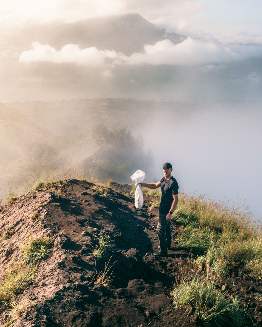 Alex with an adventure bag on Bali's Mount Batur