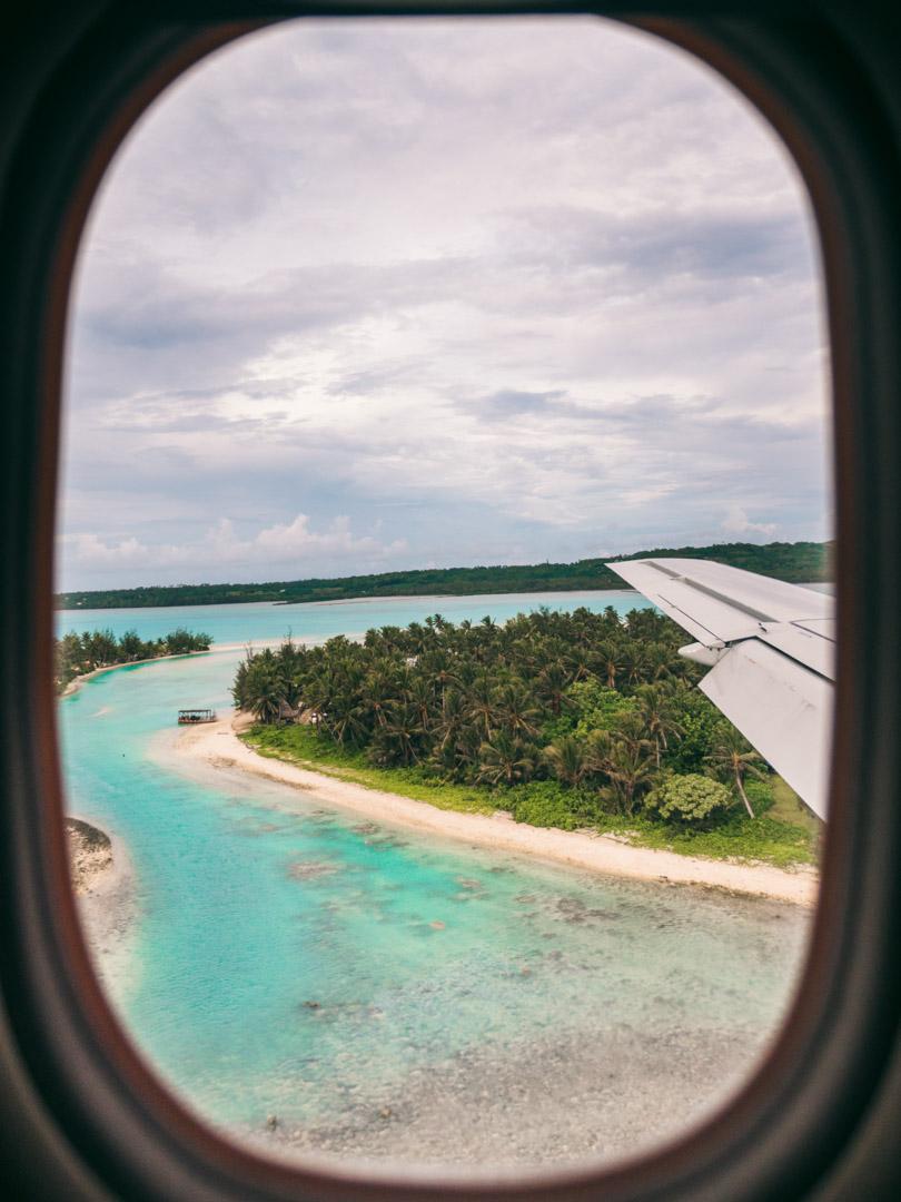 Flying into Aitutaki seen through the plane window
