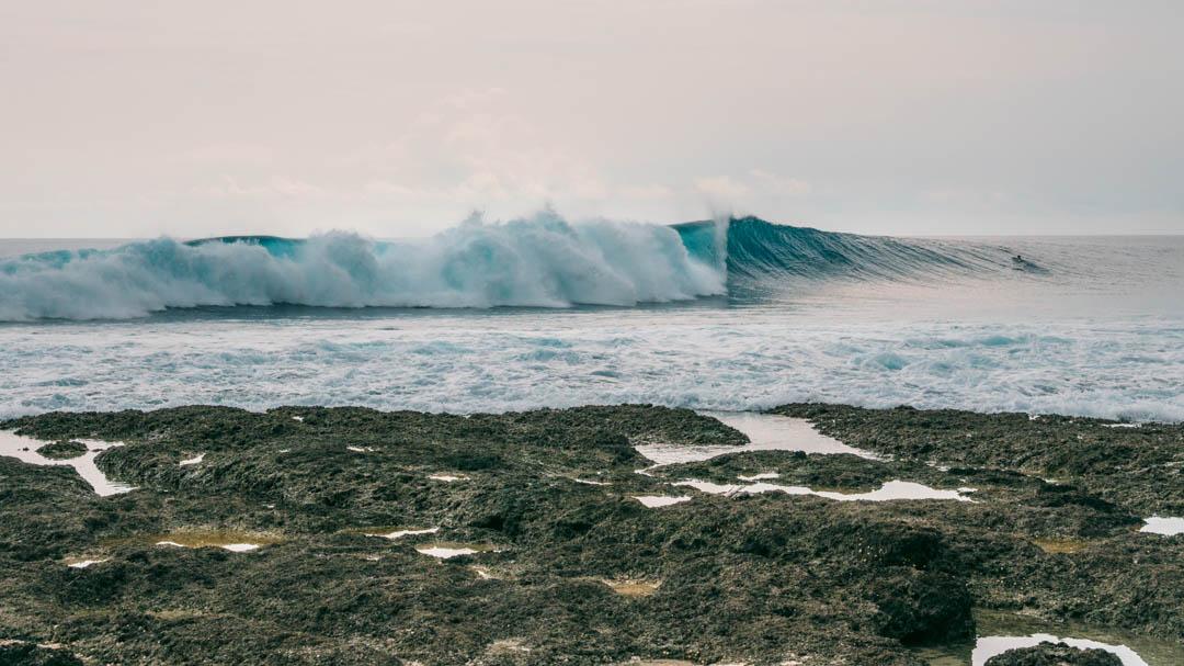 Surfing wave Asu Island