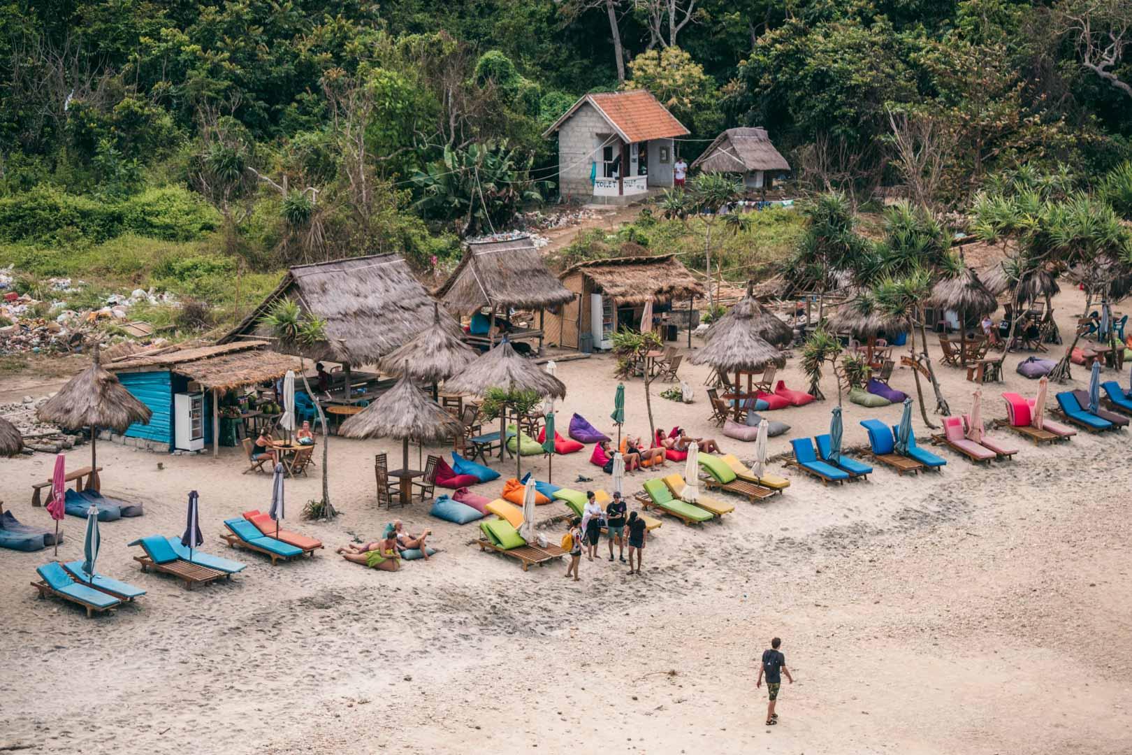 Atuh Beach sun loungers and warungs