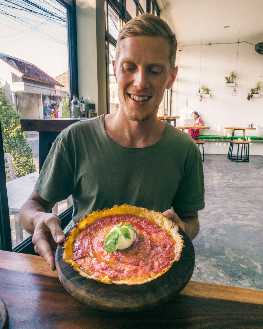 Gluten-free pizza with pumpkin crust and vegan burrata