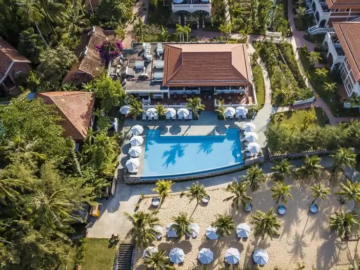 Cassia Cottage as seen from above with the restaurant, pool and beach