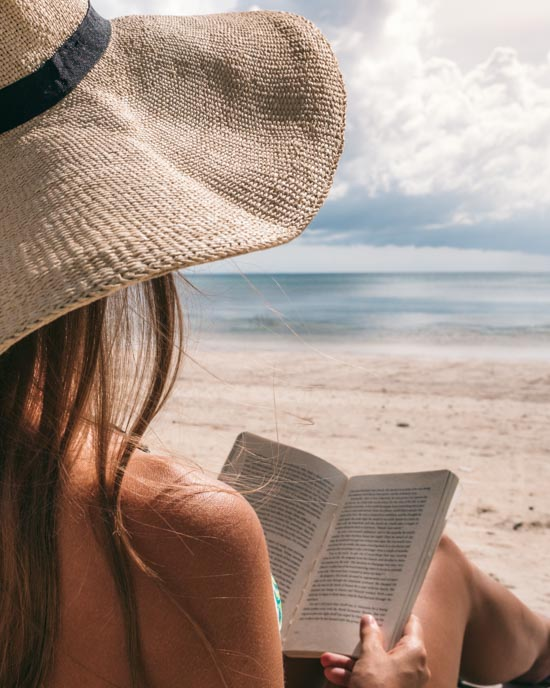 Victoria reading on beach