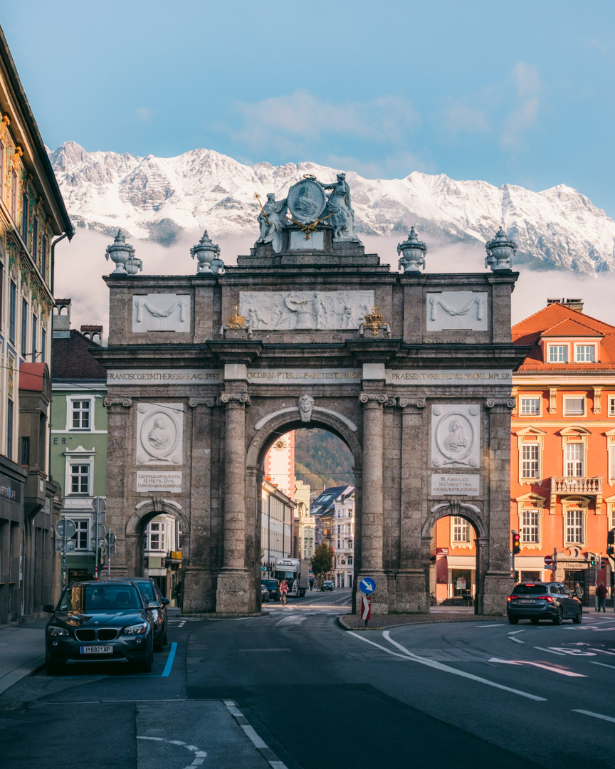 The Triumphal Arch in Innsbruck with the Nordkette Range behind it