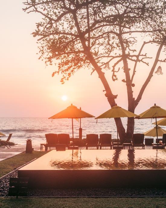 Sunrise behind pool