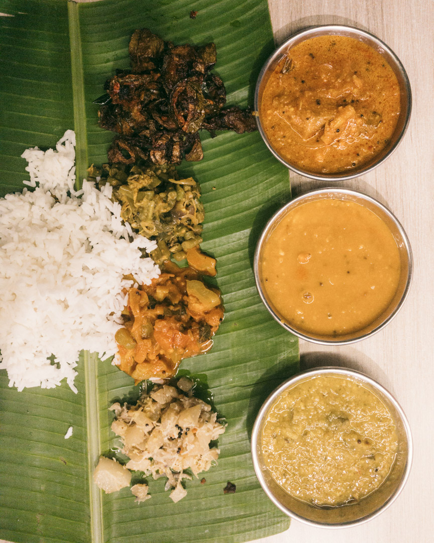 Banana leaf with rice and curries at Bala's