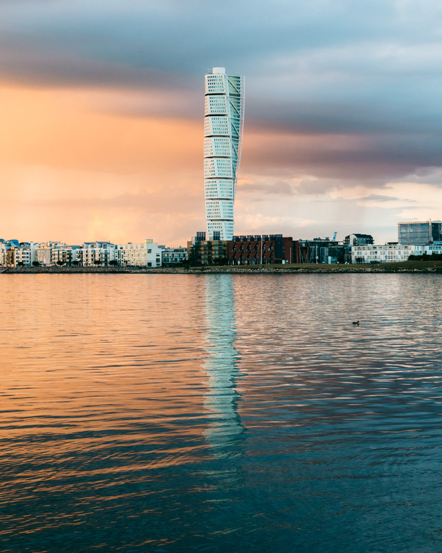 Turning Torso reflecting in the water as seen from Ribersborg Beach