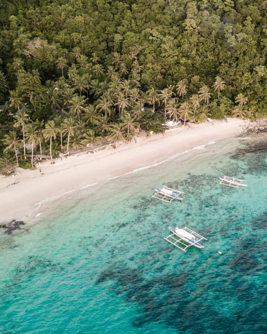 The private beach of Coconut Garden Island Resort on Cacnipa Island