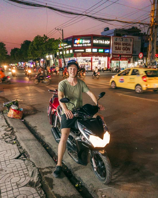 Alex on our scooter in the middle of Duong Dong