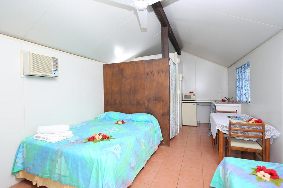 A simple bungalow by the beach at Ranginuis Retreat in Aitutaki