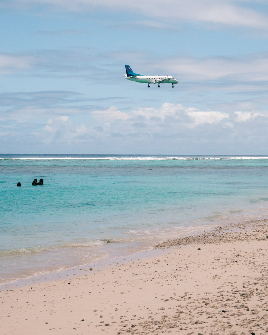 A flight arriving over Black Rock Beach in Rarotonga