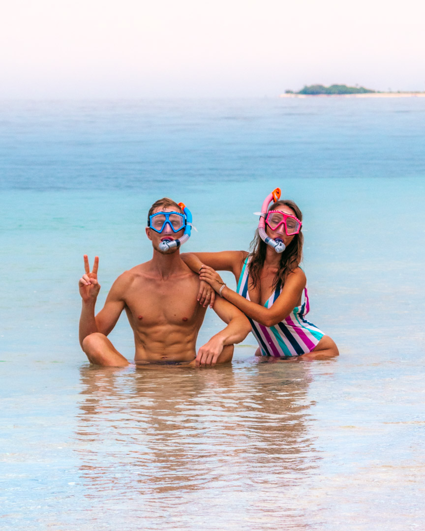 Alex and Victoria with snorkel masks in Indonesia