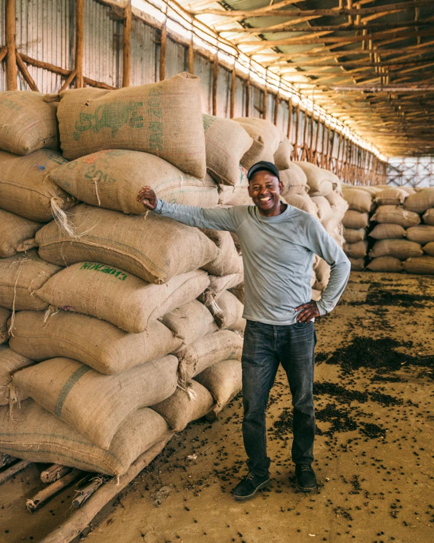 Akmel with his coffee bags