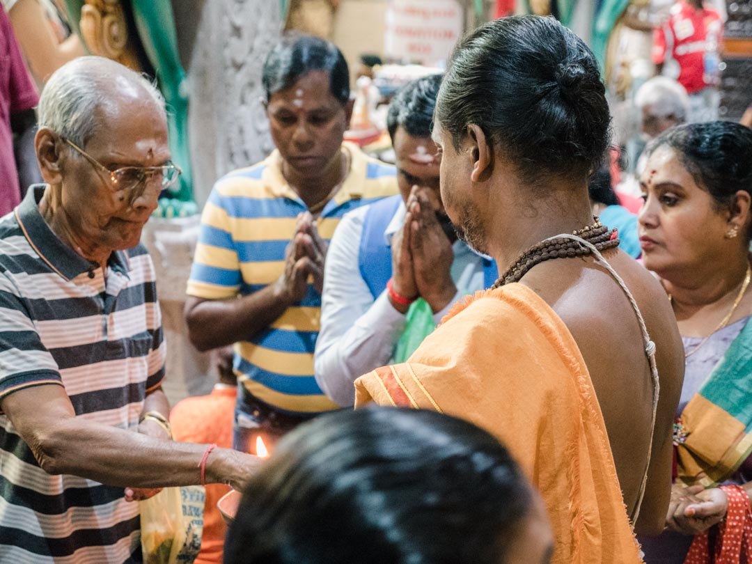 Praying in a Little India temple