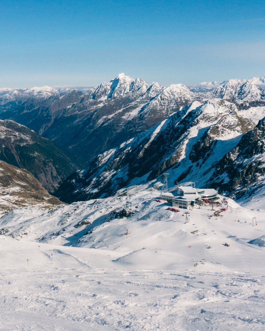 Skiing in October with a clear blue sky
