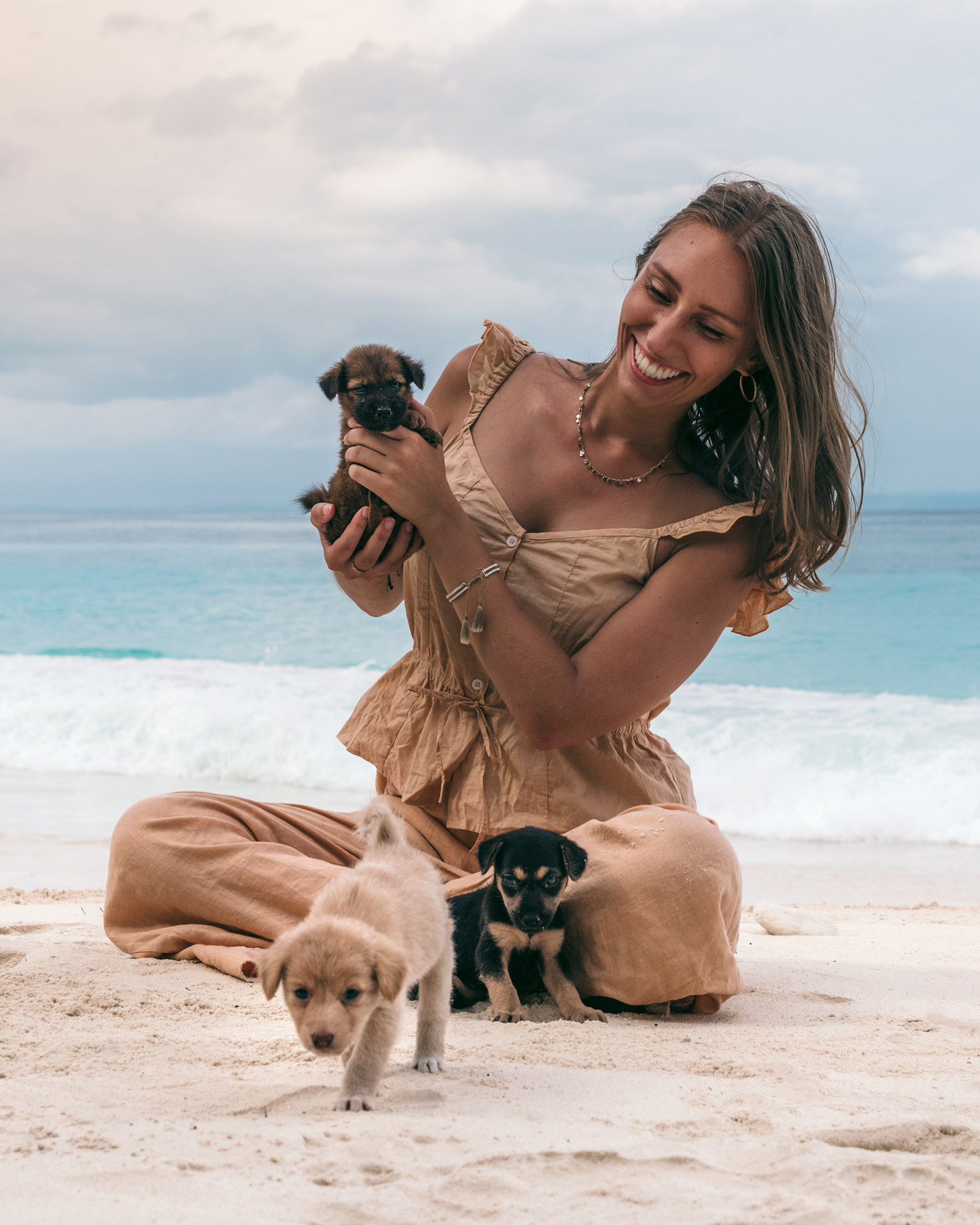 Puppies on beach with Victoria