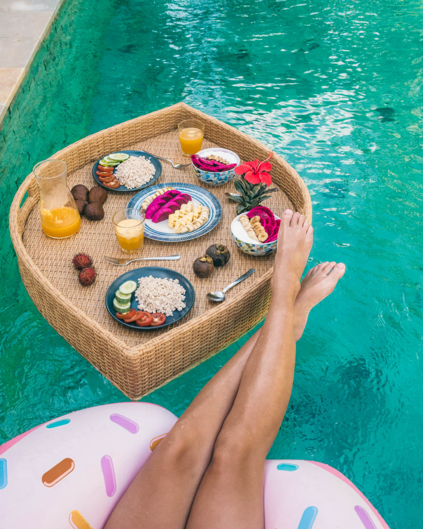 Eating vegan breakfast in a pool in Lombok, Indonesia