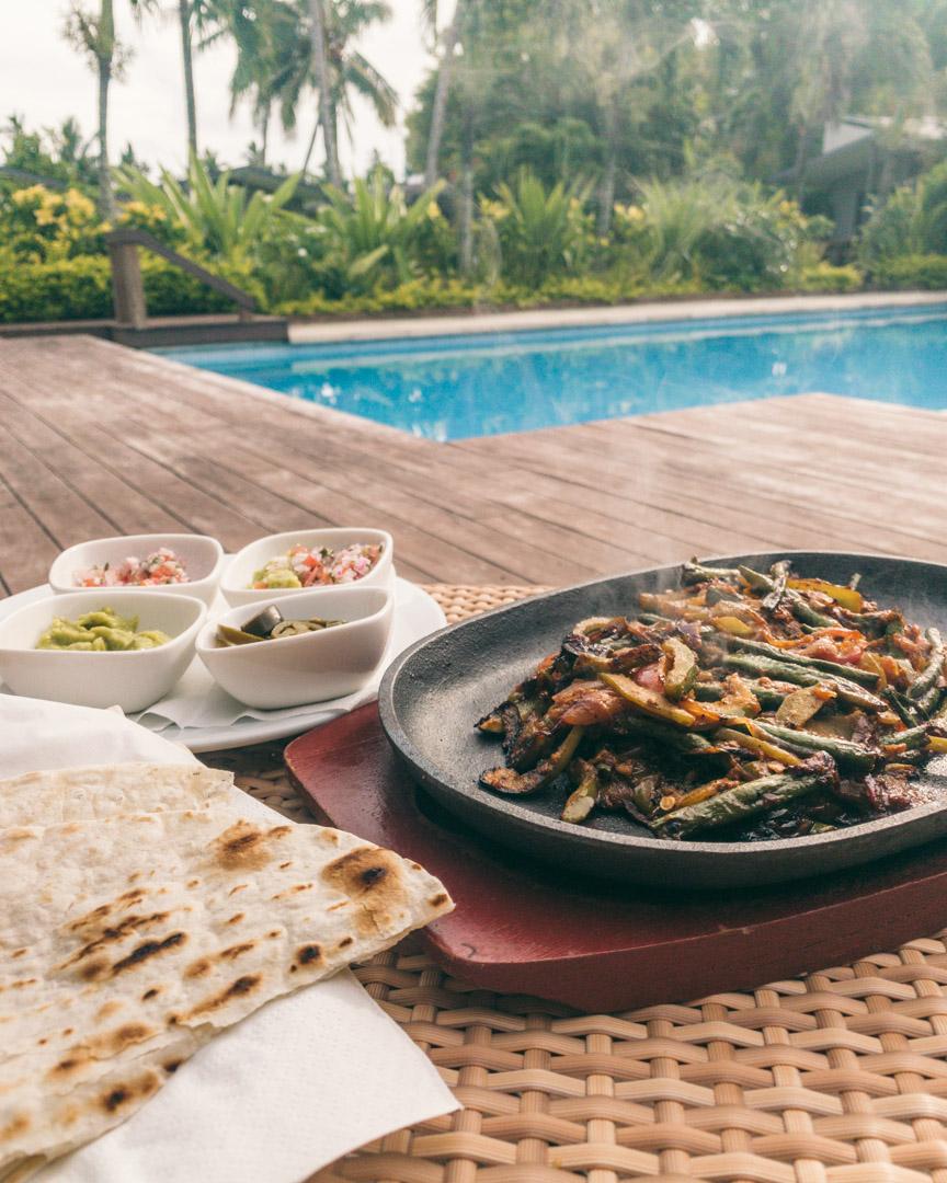 Sizzling fajitas served poolside