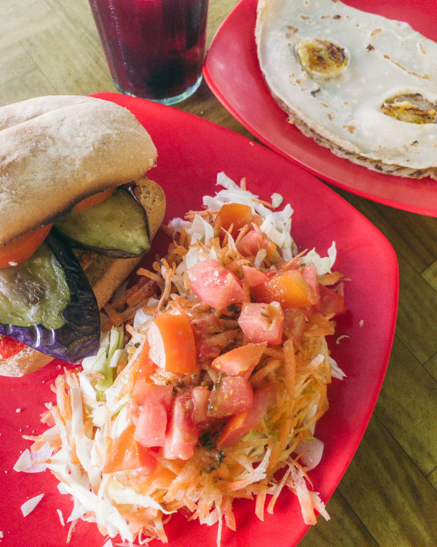 Vegan Tempeh Burger in a ciabatta bun and a banana pancake