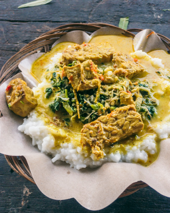 Rice, curry, urap, tempeh and tofu at a street stall