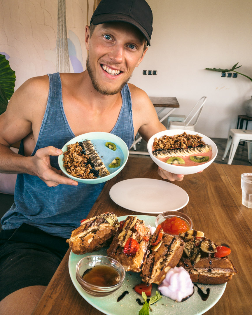 Alex with smoothie bowls in Bali