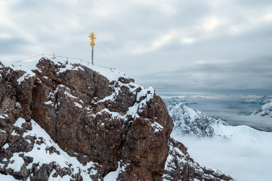 The iconic cross indicates the actual top of Zugspitze.